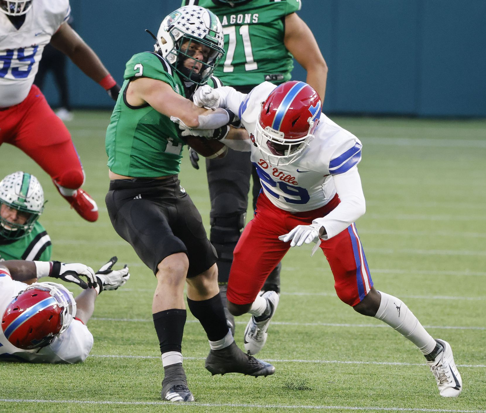 Southlake running back Owen Allen bounces off an attempted tackle by Duncanville defender Willie Angton Jr. (29) to score a touchdown during the Class 6A Division I state high school football semifinal in Arlington, Texas on Jan. 9, 2020. (Michael Ainsworth)