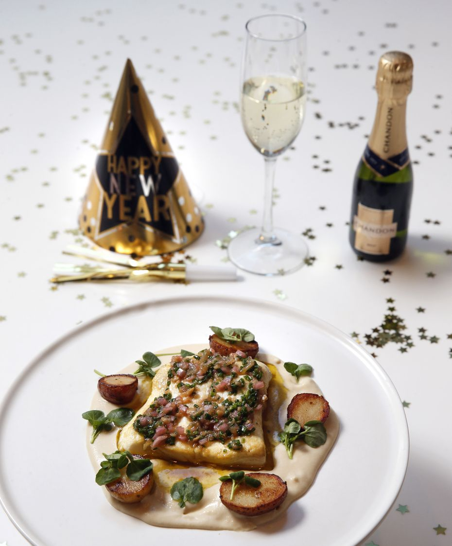 Roasted halibut with potato cream and a gremolata vinaigrette is part of the New Year's Eve offering at Sloane's Corner.