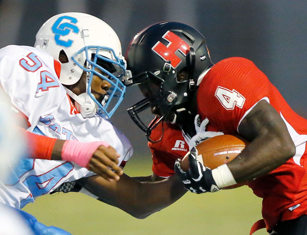 Hillcrest High running back Nasir Reynolds (4) comes face-to-face with defensive end Randy Anthony during the second quarter at Hillcrest's Franklin Stadium in Dallas, Thursday, October 18, 2018. (Tom Fox/The Dallas Morning News)