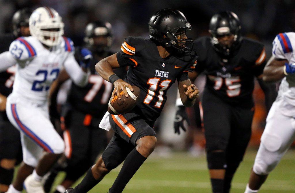 Lancaster quarterback James Mitchell (11) rolls out looking for a receiver against Duncanville in the fourth quarter at Beverly D. Humphrey Tiger Stadium in Lancaster Texas, Friday, August 30, 2019. Duncanville won, 24-3. (Tom Fox/The Dallas Morning News)