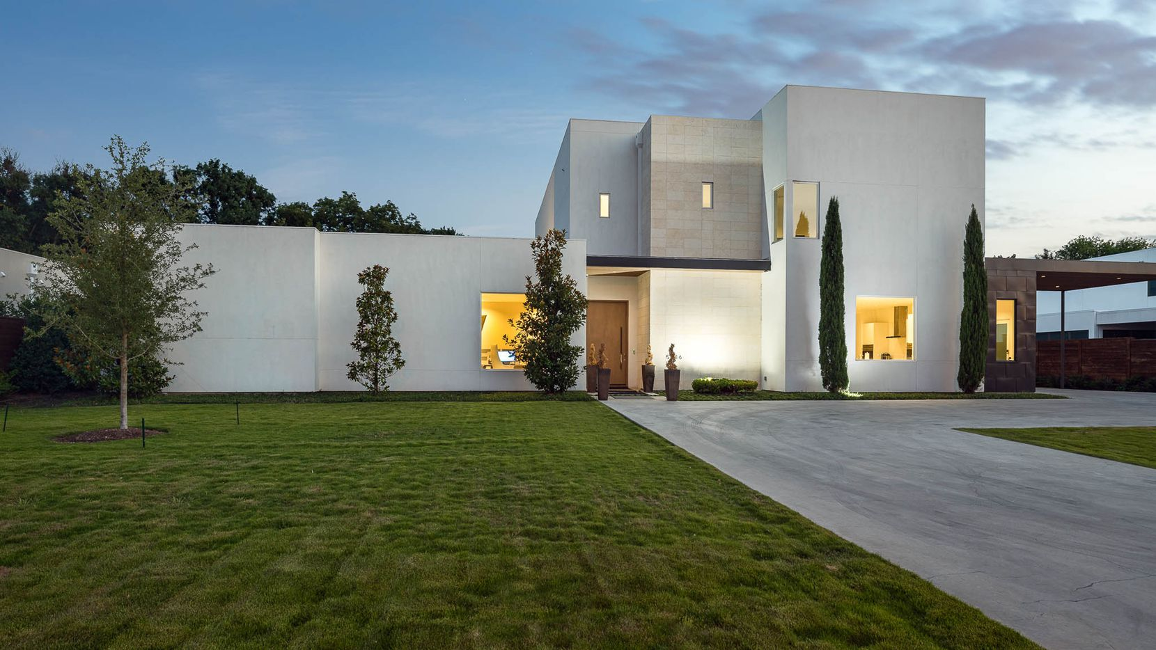 The five-bedroom contemporary estate at 5816 Walnut Hill Lane in Preston Hollow has a four-car, drive-through garage with lifts.