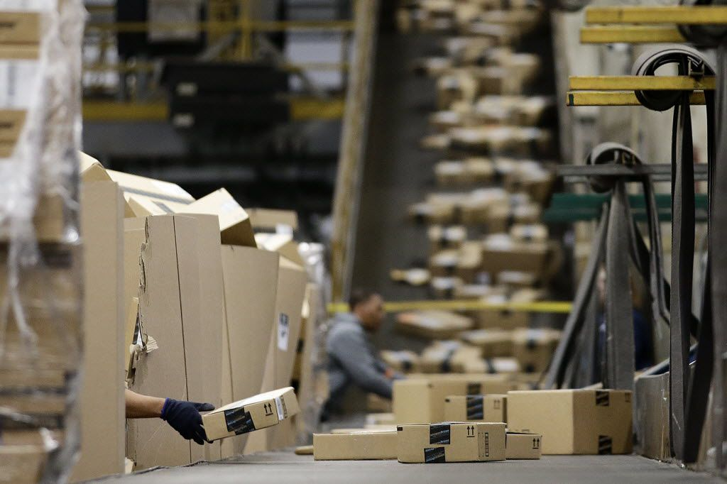 Workers sort packages at a FedEx hub at Los Angeles International Airport.