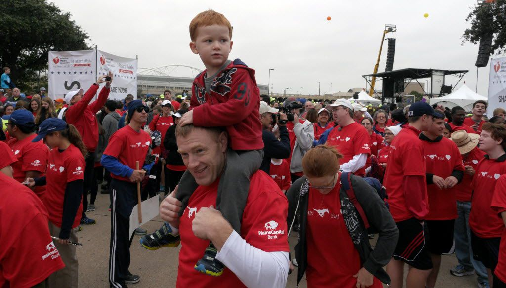 Luke Hudson and his dad Herman Hudson wait for the Dallas Heart Walk to start. (File Photo/Staff)