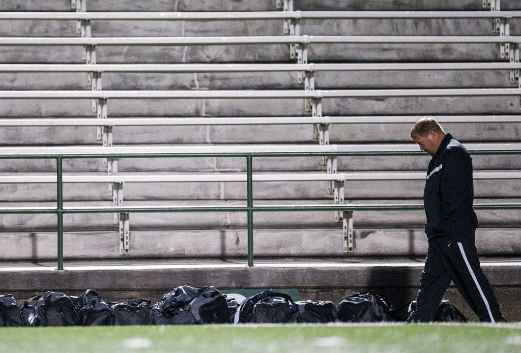 Forney High School soccer coach Kris Duplissey walks along the sideline during halftime of a game in January 2018.