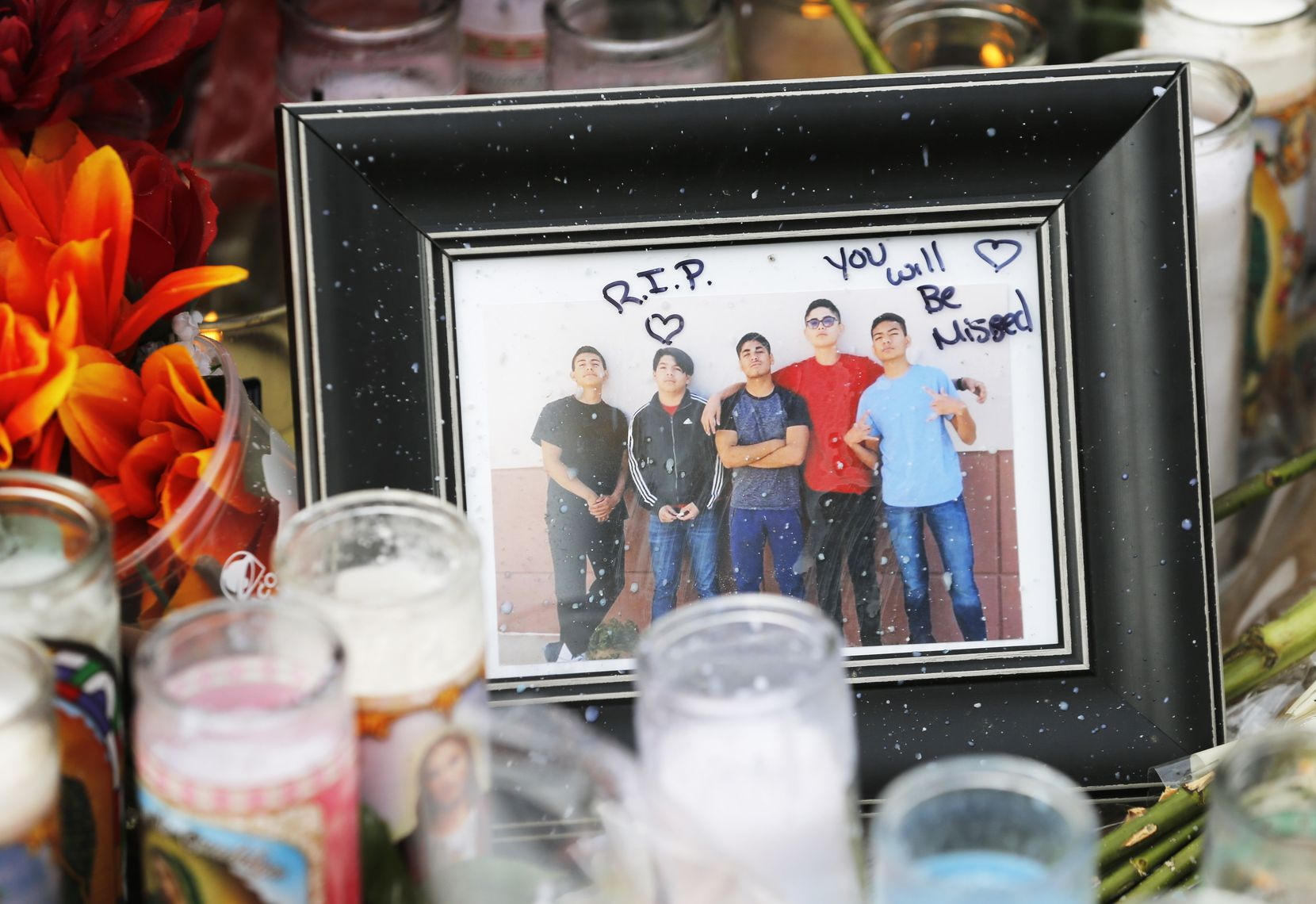 Photo of Javier Amir Rodriguez (second from left) left near a cross with his name on it at a makeshift memorial for victims at a shopping complex near the Walmart of a mass shooting in El Paso, Texas on Tuesday, August 6, 2019.