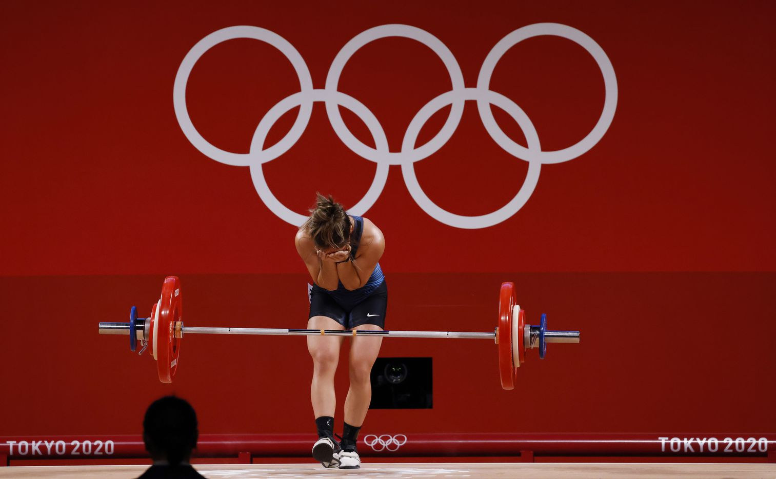 USA's Jourdan Delacruz attempts to lift 89kg on her third attempt of the snatch round during the women's 49 kg weightlifting final  during the postponed 2020 Tokyo Olympics at Tokyo International Forum on Saturday, July 24, 2021, in Tokyo, Japan. Delacruz received a no-lift from the judges on this lift. (Vernon Bryant/The Dallas Morning News)