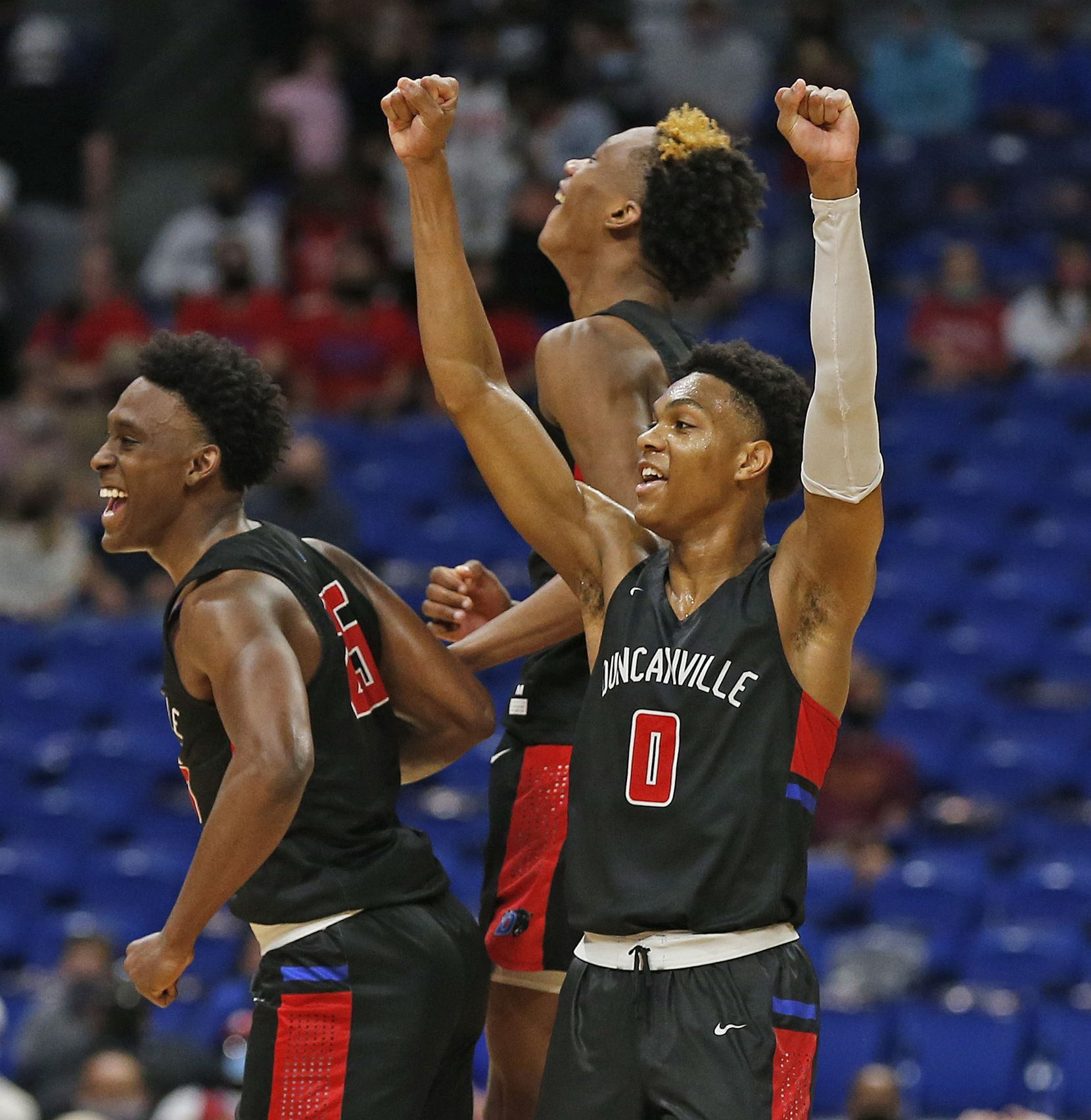 Duncanville Zhuric Phelps #0 celebrates with teammates. UIL boys Class 6A basketball state championship game between Duncanville and Austin Westlake on Saturday, March 13, 2021 at the Alamodome.