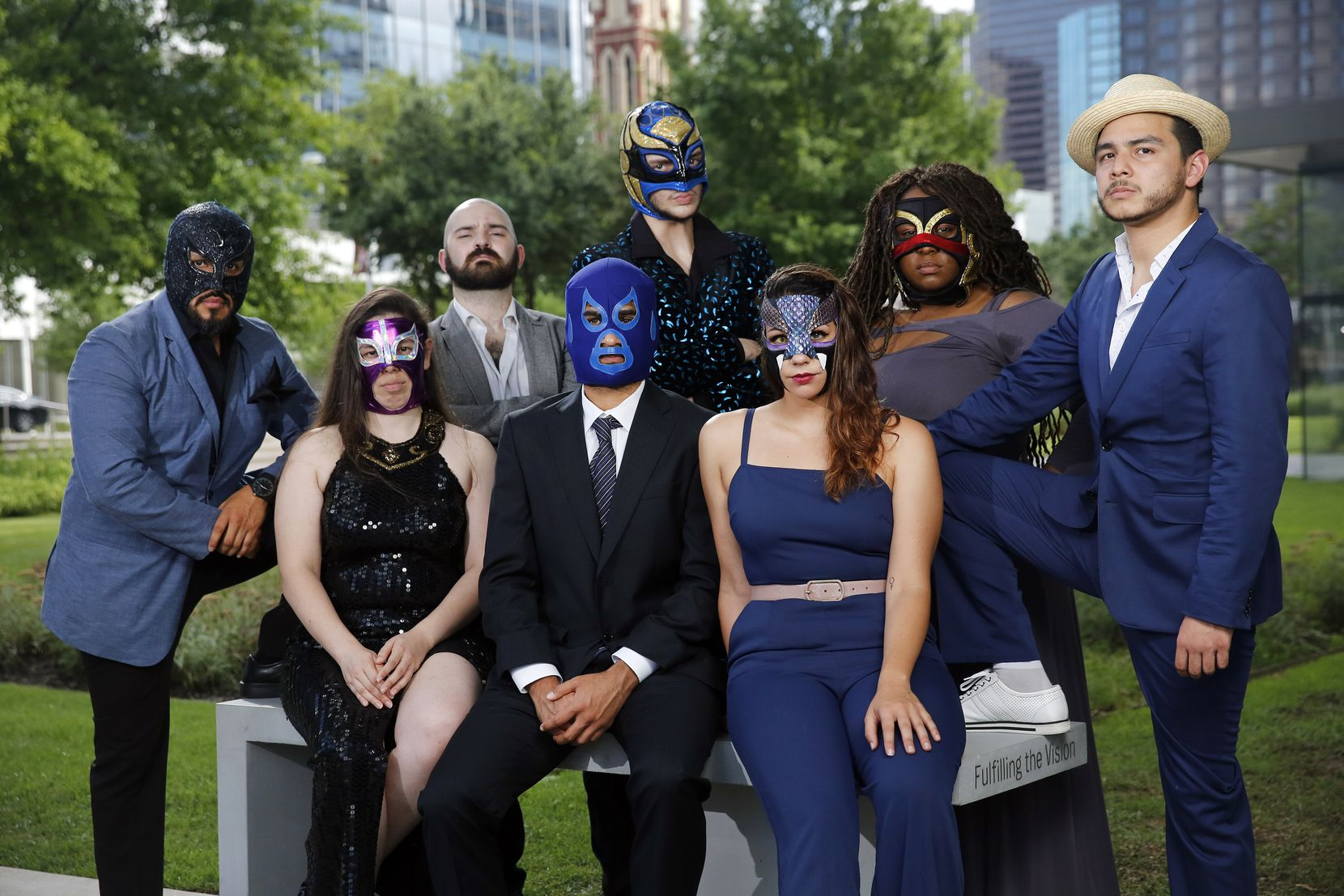 """The cast and co-writers of """"Lucha Teotl"""" pose for a portrait in the Dallas Arts District, where the play about Mexican """"lucha libre"""" culture will be performed."""