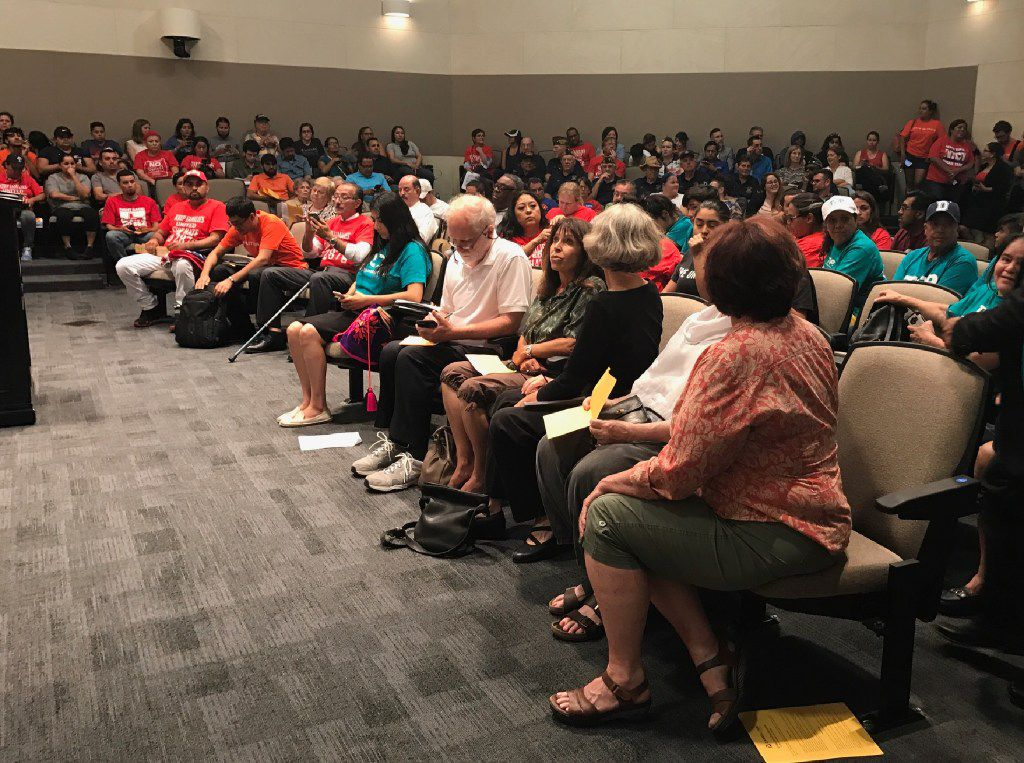 Carrollton residents and immigrant advocates gathered at Carrollton City Hall in July to voice their opposition to the city's 287(g) program.