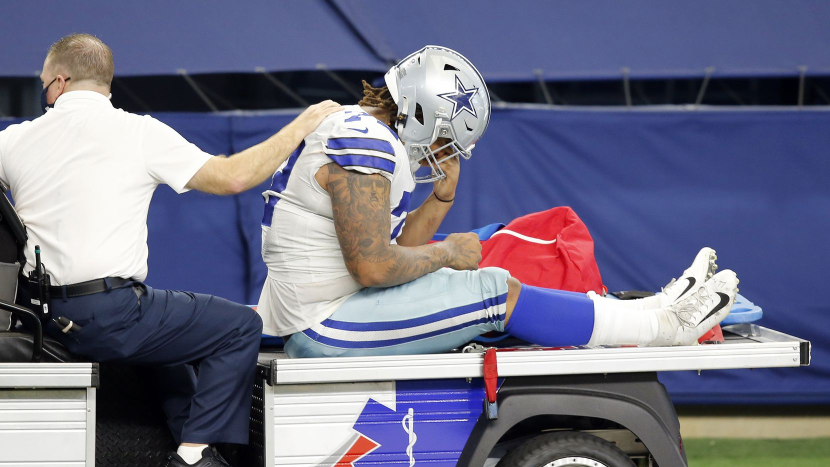 Dallas Cowboys defensive tackle Trysten Hill (72) is carted off the field after sustaining an injury against the New York Giants at AT&T Stadium Stadium in Arlington, Texas, Sunday, October 11, 2020.