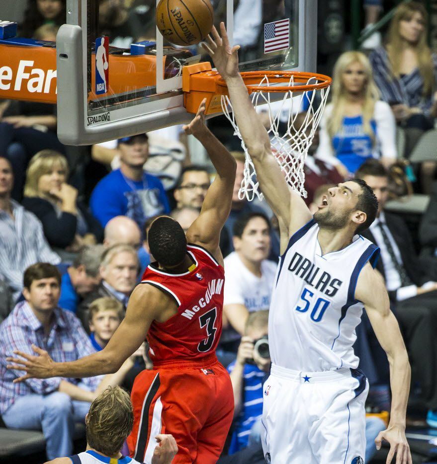 Dallas Mavericks center Salah Mejri (50) defends a shot by Portland Trail Blazers guard C.J. McCollum (3) during the second half of an NBA basketball game at American Airlines Center on Sunday, March 20, 2016, in Dallas. (Smiley N. Pool/The Dallas Morning News)