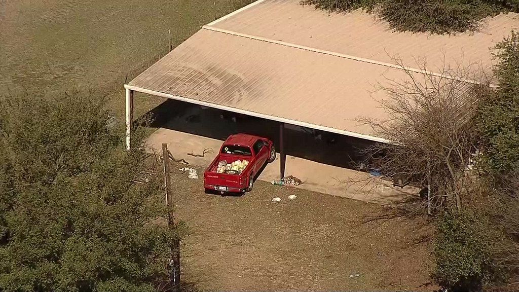 An aerial photo shows the home where officials say Wise County Sheriff's deputies found four malnourished children under the age of 6, including two locked in a dog kennel, earlier this month.