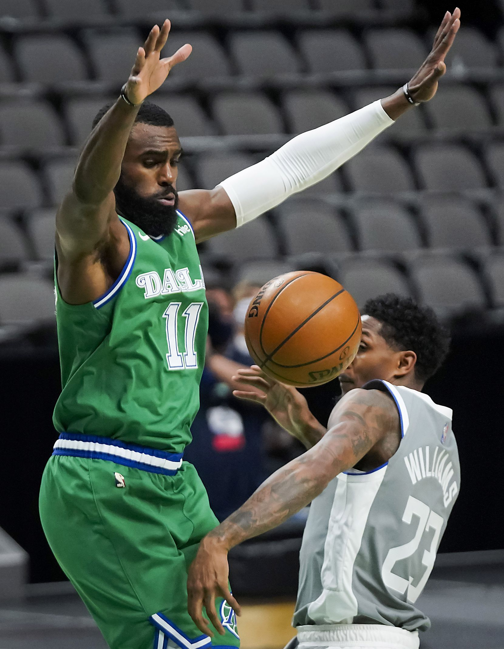 Dallas Mavericks forward Tim Hardaway Jr. (11) defends against LA Clippers guard Lou Williams (23) during the second half of an NBA basketball game at American Airlines Center on Wednesday, March 17, 2021, in Dallas.