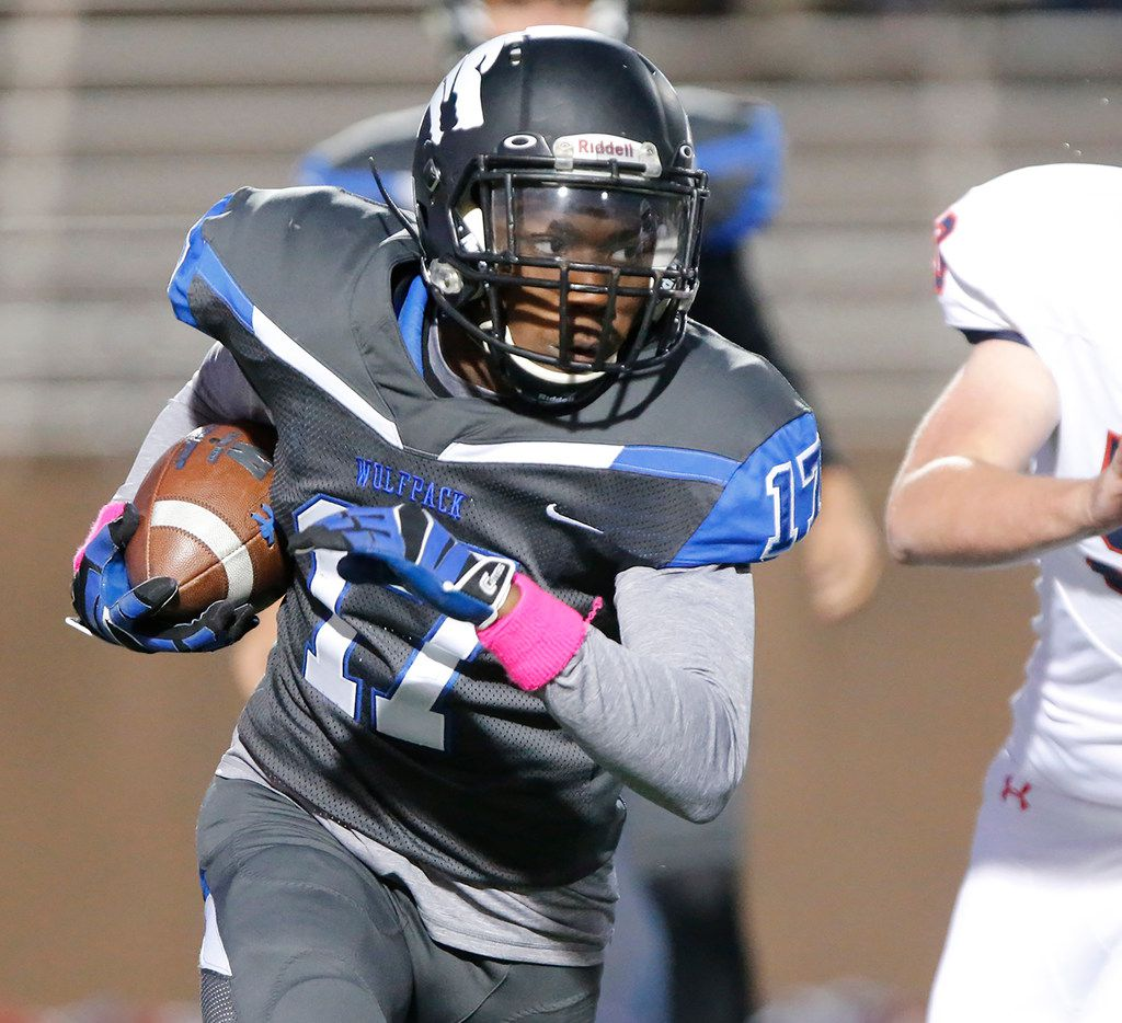 Plano West High School running back Kamryn Settles (17) carries the football during the first half as Plano West High School hosted McKinney Boyd High School at Clark Stadium in Plano on Friday night, October 11, 2019.