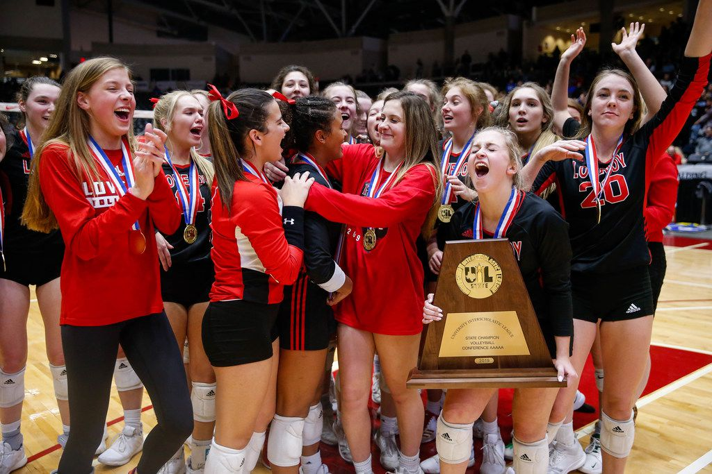 The Lucas Lovejoy Leopards celebrate after winning a class 5A volleyball state semifinal match against Canyon Randall at the Curtis Culwell Center in Garland, on Saturday, November 23, 2019. Lovejoy won all three sets 27-25, 25-17 and 25-15. (Juan Figueroa/The Dallas Morning News)