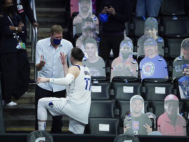 Dallas Mavericks guard Luka Doncic (77) celebrates with Dirk Nowitzki after the Mavericks 127-121 victory over the LA Clippers in an NBA playoff basketball game at Staples Center on Wednesday, May 26, 2021, in Los Angeles.
