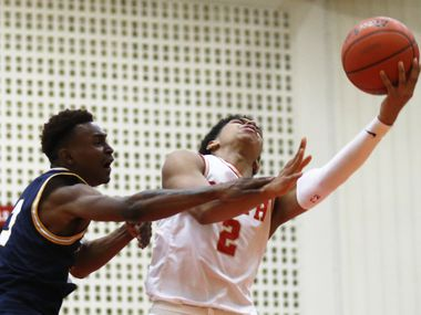 South Grand Prairie's Jordan Roberts (2) is fouled by  Arlington Lamar's Dorian Manigo (3) as he drives to the basket during the second quarter of play at South Grand Prairie High School on Tuesday, January 19, 2021in Grand Prairie, Texas. (Vernon Bryant/The Dallas Morning News)
