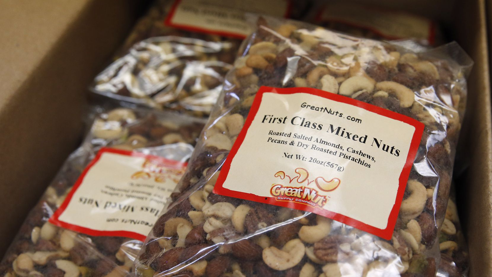 Detail of the First Class Mixed Nuts for sale at GNS Foods in Arlington, Texas on Tuesday, July 28, 2020. GNS Foods sold 12 million pounds of nuts to airlines last year that were dished out warm as a premium service to first class customers, particularly American Airlines. Sales to airlines has dropped dramatically due to the stoppage of serving nuts due to the COVID-19 pandemic. (Vernon Bryant/The Dallas Morning News)