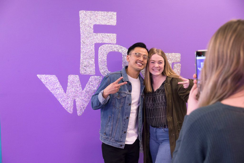 Hammer Vong, left, of Grand Prairie, Texas and Kayla Stoetzel, right, of Arlington, Texas pose as Hunter Deane takes their photo inside Snap 151, a pop-up installation, in Fort Worth, Texas on Thursday, January 17, 2019. The pop-up runs from 10 a.m.-10 p.m. until January 27. (Daniel Carde/The Dallas Morning News)