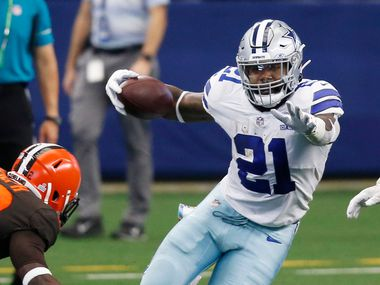 Dallas Cowboys running back Ezekiel Elliott (21) attempts to break away from Cleveland Browns strong safety Karl Joseph (42) during the second quarter of play at AT&T Stadium in Arlington, Texas on Saturday, October 4, 2020.