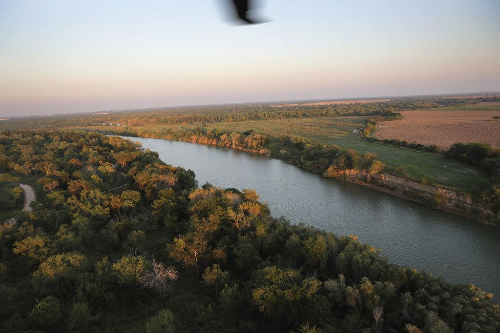 MCALLEN, TX - NOVEMBER 06:  The Rio Grande flows along the U.S.-Mexico border at dusk, as seen from a U.S. Air and Marine Operations helicopter patrol on November 6, 2018 in McAllen, Texas. The border line between Mexico (R), and the United States falls in the middle of the river through the southern length of Texas.