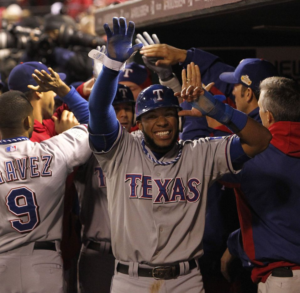 texas SS Elvis Andrus is all smiles as teammates congratulate him in the dugout after he scored the go-ahead run in the ninth inning in Texas' 2-1 win during Game 2 of the World Series between the Texas Rangers and St. Louis Cardinals at Busch Stadium in St. Louis on Thursday, Oct. 20, 2011. (Louis DeLuca/Dallas Morning News) 10212011xNEWS 10222011xALDIA