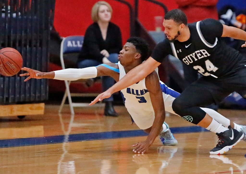 Allen High School guard Tyrone Woods (3) goes for a loose ball with Denton Guyer High School forward JaKobe Coles (24) during the first half as Allen High School hosted Denton Guyer High School in a non-district basketball game on Tuesday, December 3, 2019. (Stewart F. House/Special Contributor)