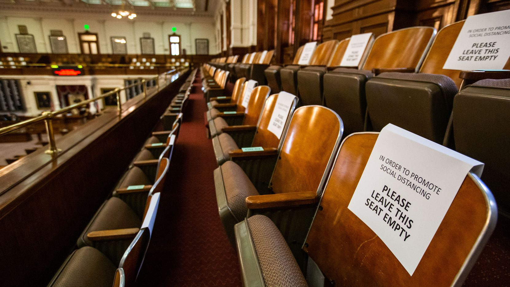 Signs enforcing physical distancing have been placed in guest seating areas in the House chamber at the Texas Capitol in Austin. The Legislature opens its session Tuesday amid a pandemic, economic recession and political strife.