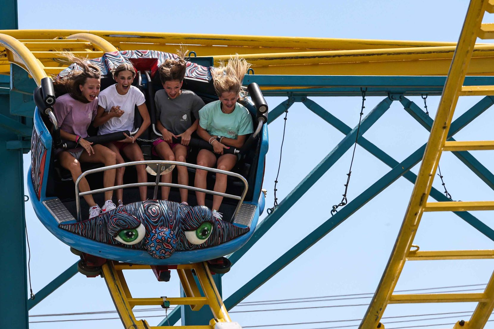 People aboard a carnival ride at the State Fair of Texas during its opening day in Dallas on Friday, September 24, 2021. The fair was canceled in 2020 due to the pandemic, making this year's event all that much more anticipated.