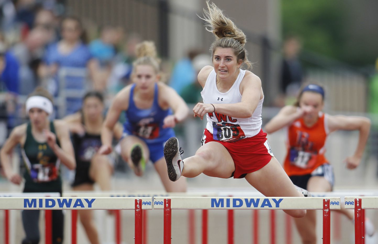 Fort Worth Christian's Abby Klipstein clears a hurdle enroute to her 1st place finish in the Class 5A Women 100 Meter hurdles event. The running finals from the TAPPS state track meet were held at Waco Midway's Panther Stadium in Hewitt on May 1, 2021. (Steve Hamm/ Special Contributor)