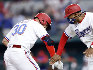 Texas Rangers batter Nate Lowe (30) is congratulated on his two-run homer by third base coach Tony Beasley in the third inning against the Toronto Blue Jays at Globe Life Field in Arlington, Tuesday, April 7, 2021.