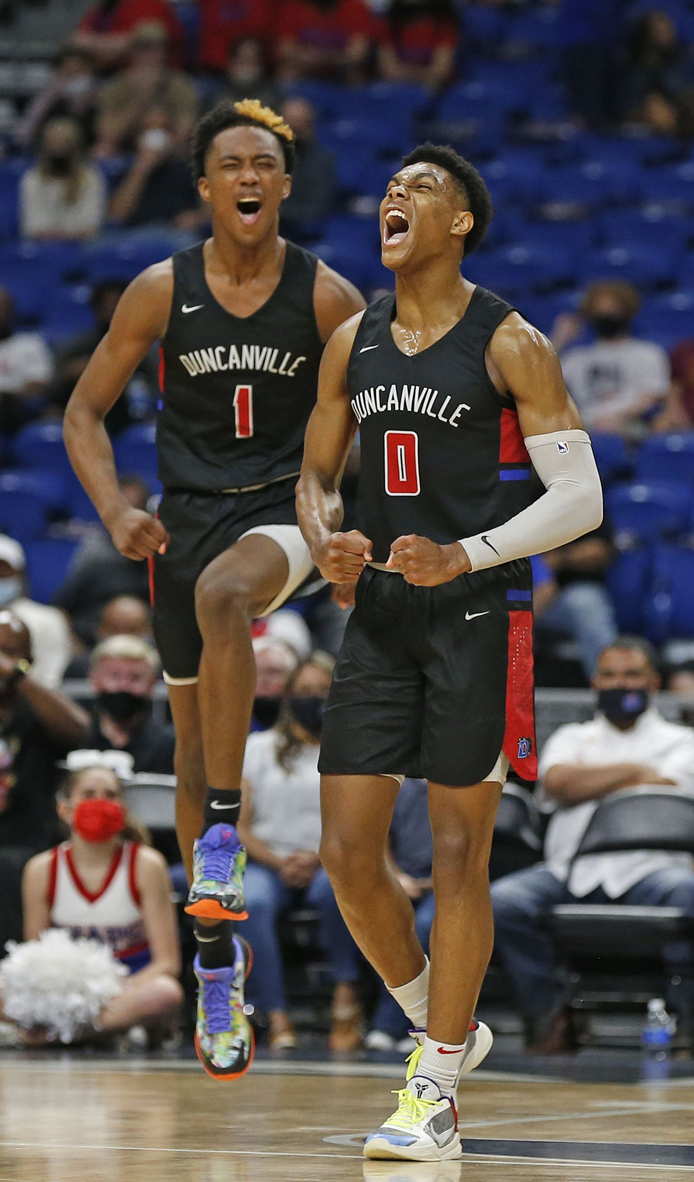 Duncanville Zhuric Phelps #0 and Duncanville Ron Holland #1 begin to celebrate in closing minute. UIL boys Class 6A basketball state championship game between Duncanville and Austin Westlake on Saturday, March 13, 2021 at the Alamodome.