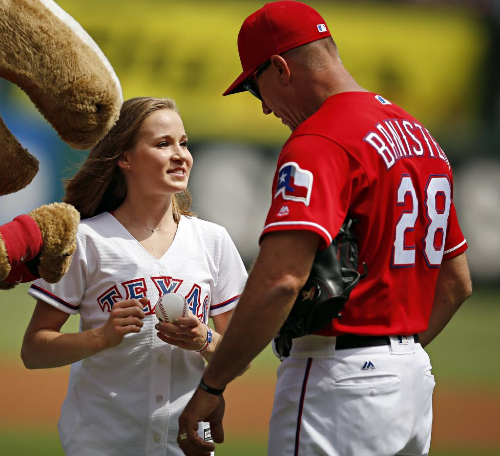 Olympic gold medalist Madison Kocian (center) smiles as she talks with Texas Rangers manager Jeff Banister after throwing out the first pitch before Texas' 12-4 win over the Houston Astros Saturday, September 3, 2016 at Globe Life Park in Arlington, Texas. (G.J. McCarthy/The Dallas Morning News)