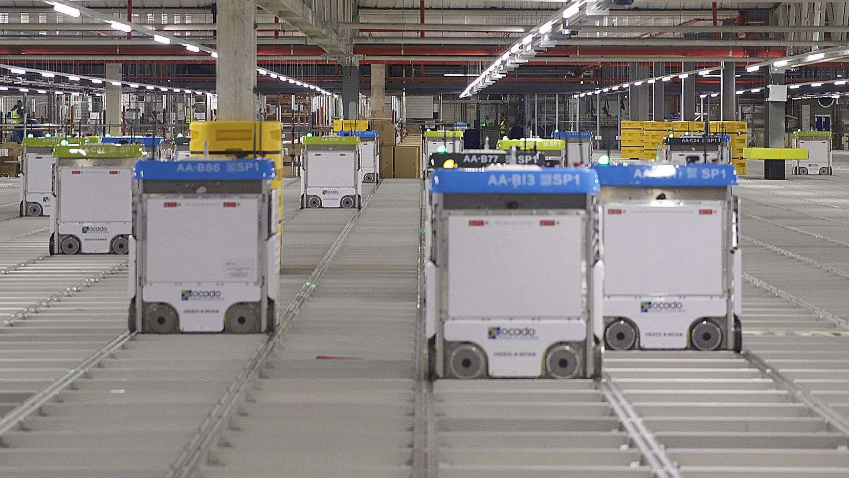 Robots on a grid at an Ocado fullfilment center in the U.K. where the company has about 600,000 active customers. Ocado entered into an exclusive partnership with Kroger to build the automated online grocery fulfillment centers in the U.S.