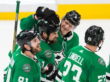 Dallas Stars celebrate a goal scored by left wing Jamie Benn (14) for a hat trick during the third period of an NHL game between the Dallas Stars and the Carolina Hurricanes on Tuesday, February 11, 2020 at American Airlines Center in Dallas.