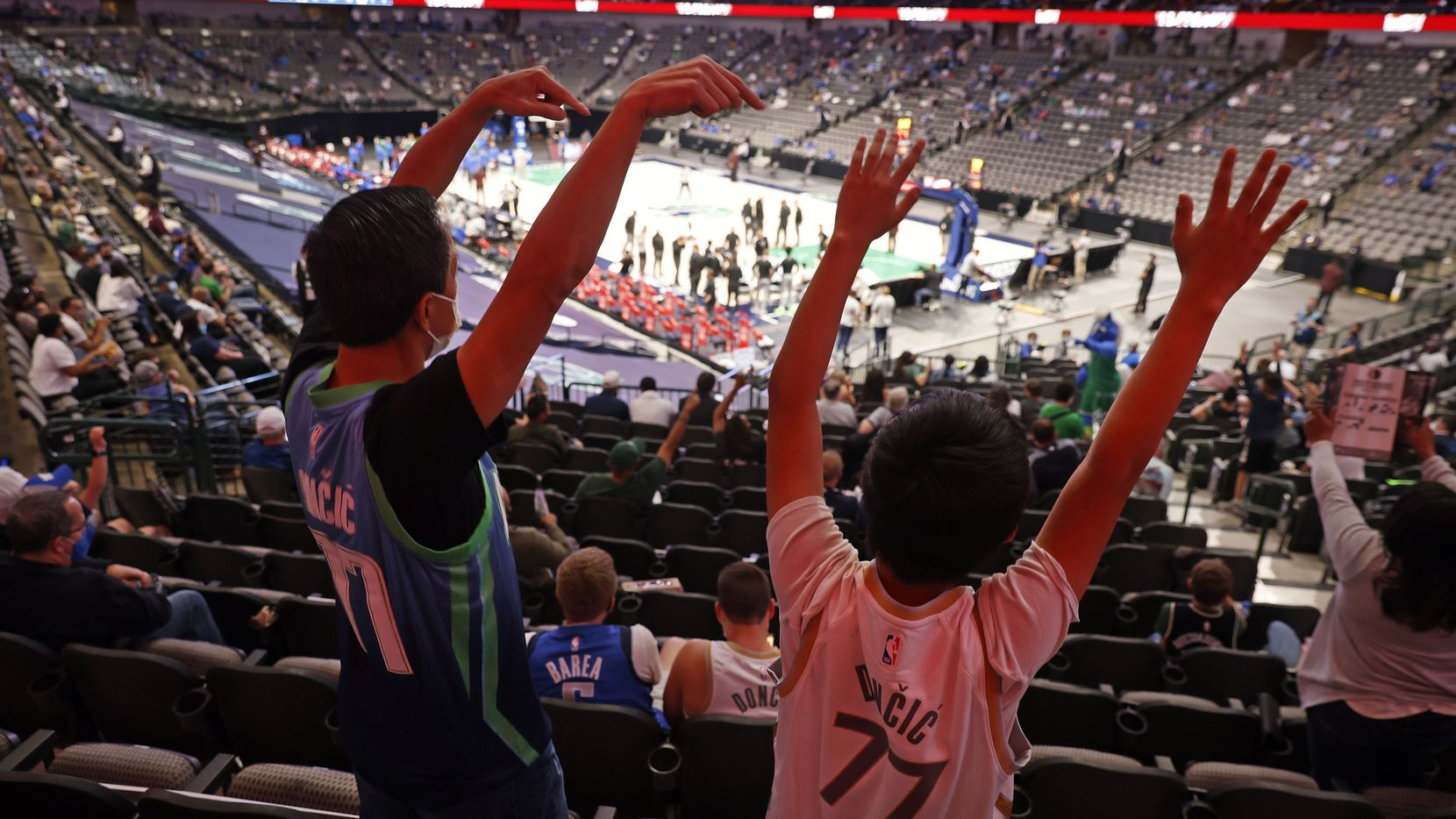 Fans of Dallas Mavericks guard Luka Doncic yell for the tam mascot during a first quarter timeout at the American Airlines Center in Dallas, Thursday, April 8, 2021. The Maverick were playing and defeated the Milwaukee Bucks, 116-101. (Tom Fox/The Dallas Morning News)