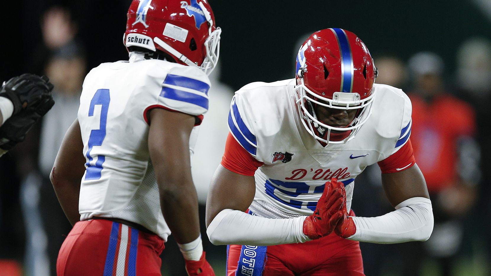 Duncanville linebacker Jordan Crook (2) looks on as defensive end Omari Abor (23) celebrates a sack in the first half of the Class 6A Div. I Region II final against DeSoto on Saturday, Jan. 2, 2021.