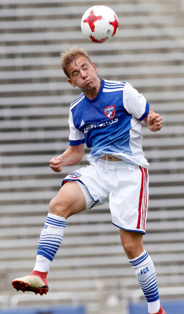 FC Dallas' Paxton Pomykal (19) heads the ball away from an Arsenal FC opponent during first half action. The two teams played in the Boys U19 Super Group bracket. Arsenal FC won the contest, 2-1. The game was part of the Dallas Cup competition held at the Cotton Bowl in Dallas on March 25, 2018. (Steve Hamm/Special Contributor)