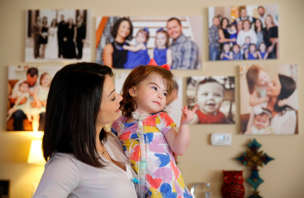 Natalie Gregory (left) needs 24-hour medical care for her 2 year-old daughter Christina who suffers from CCHS (Congenital Central Hypoventilation Syndrome), a genetic disorder that affects her breathing. The Gregory's have two pediatric nurses that keep a watchful eye on Christina at their Southlake,Texas home. Christina has to wear a diaphragmatic pace maker in a backpack that keeps her breathing on track as well as a ventilator unit that hooks up to a trach tube in her neck. The Gregorys are affected by Texas' change to their Medicare healthcare coverage, switching to a MCO plan from an HMO plan, limiting their care to within the region -a cumbersome issue for families dealing with 24/7 care. They are photographed Tuesday, January 31, 2017. (Tom Fox/The Dallas Morning News)
