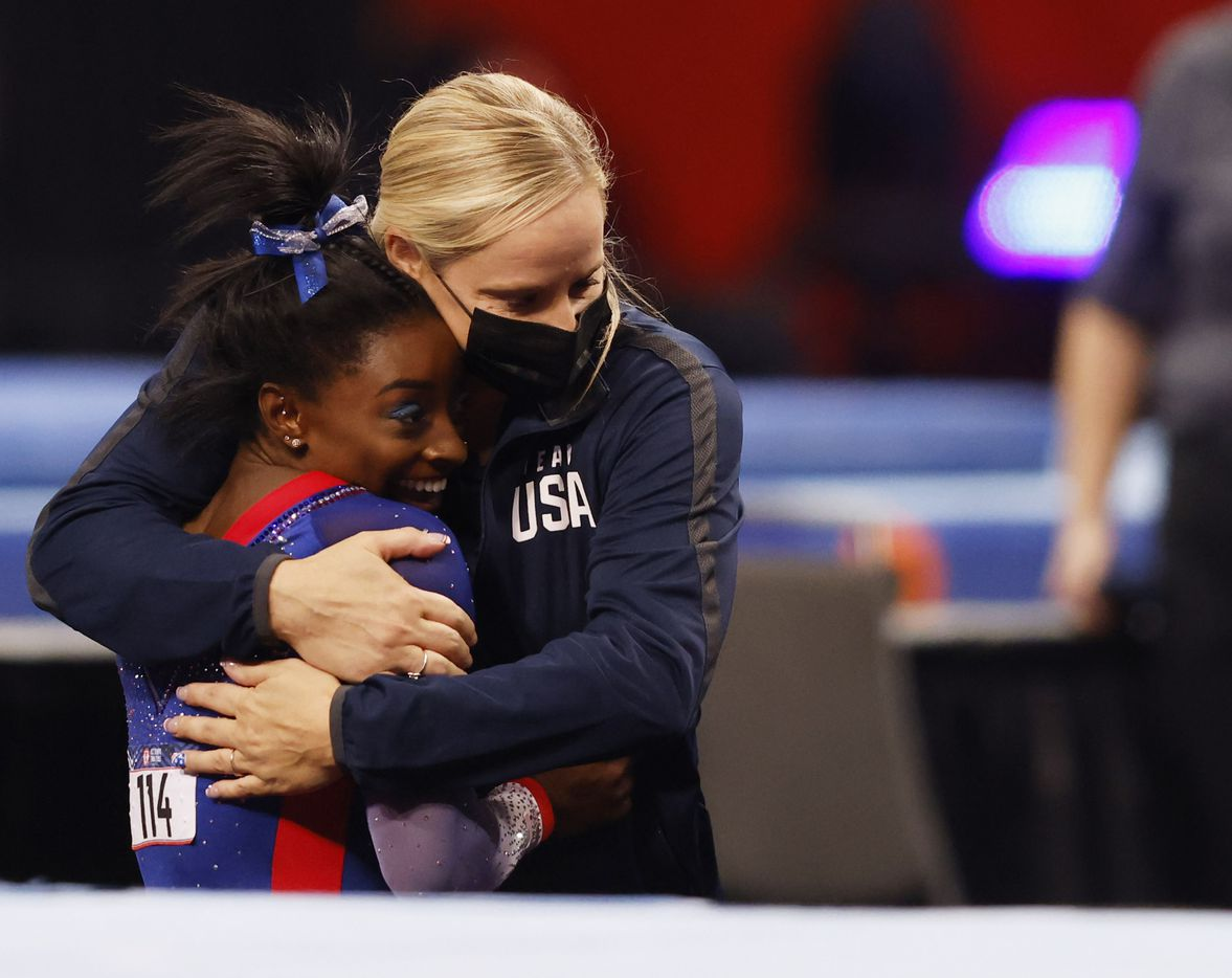 Simone Biles of World Champions hugs her coach coach Cecile Landi after competing in the floor exercise during day 1 of the women's 2021 U.S. Olympic Trials at America's Center on Friday, June 25, 2021 in St Louis, Missouri.(Vernon Bryant/The Dallas Morning News)