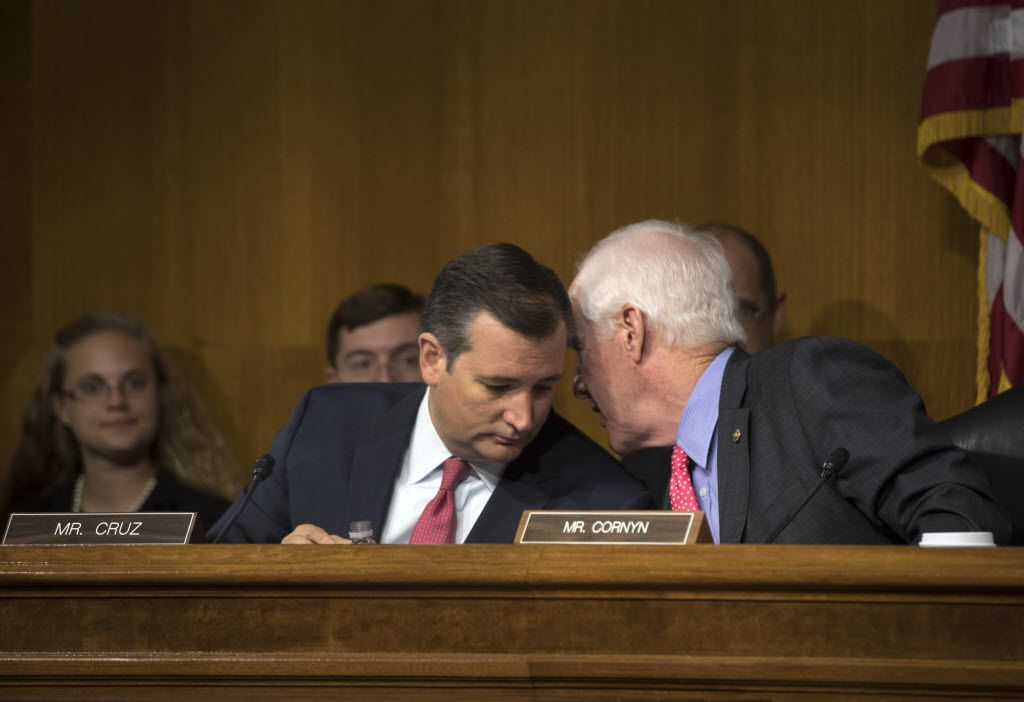 Texas Sens. Ted Cruz and John Cornyn conferred during a subcommittee meeting in 2016.