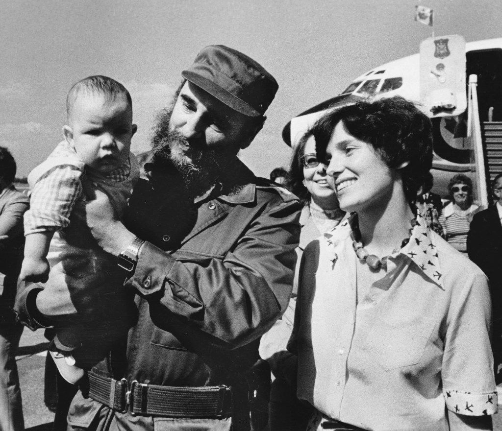 In this Jan. 26, 1976 photo, Margaret Trudeau smiles as Cuban President Fidel Castro holds her youngest son Michel after the Trudeaus arrived in Havana, Cuba.