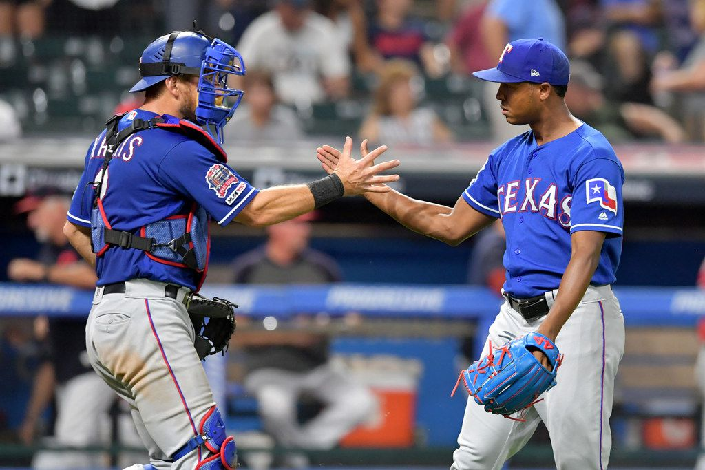 CLEVELAND, OHIO - AUGUST 05: Catcher Jeff Mathis #2 celebrates with closing pitcher Jose Leclerc #25 of the Texas Rangers after the Rangers defeated the Cleveland Indians at Progressive Field on August 05, 2019 in Cleveland, Ohio. The Rangers defeated the Indians 1-0. (Photo by Jason Miller/Getty Images)