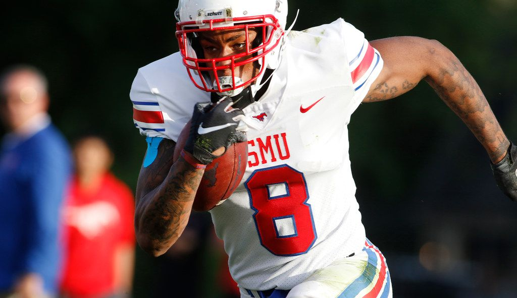 "SMU receiver Reggie Roberson Jr (8) sprints to the end zone after pulling in a pass and avoiding a defender during an offensive drive. The SMU Mustangs Football team held an ""open practice"" in place of the originally scheduled spring game at SMU's Pettus Practice Fields in Dallas on April 12, 2019."
