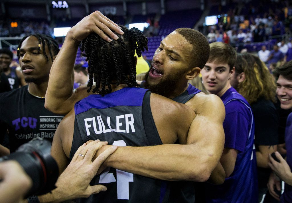 TCU Horned Frogs guard Edric Dennis (2) and guard PJ Fuller (4) celebrate after fans rush the court because of a 75-72 win over Baylor on Saturday, February 29, 2020 at Ed & Rae Schollmaier Arena on the TCU campus in Fort Worth. (Ashley Landis/The Dallas Morning News)