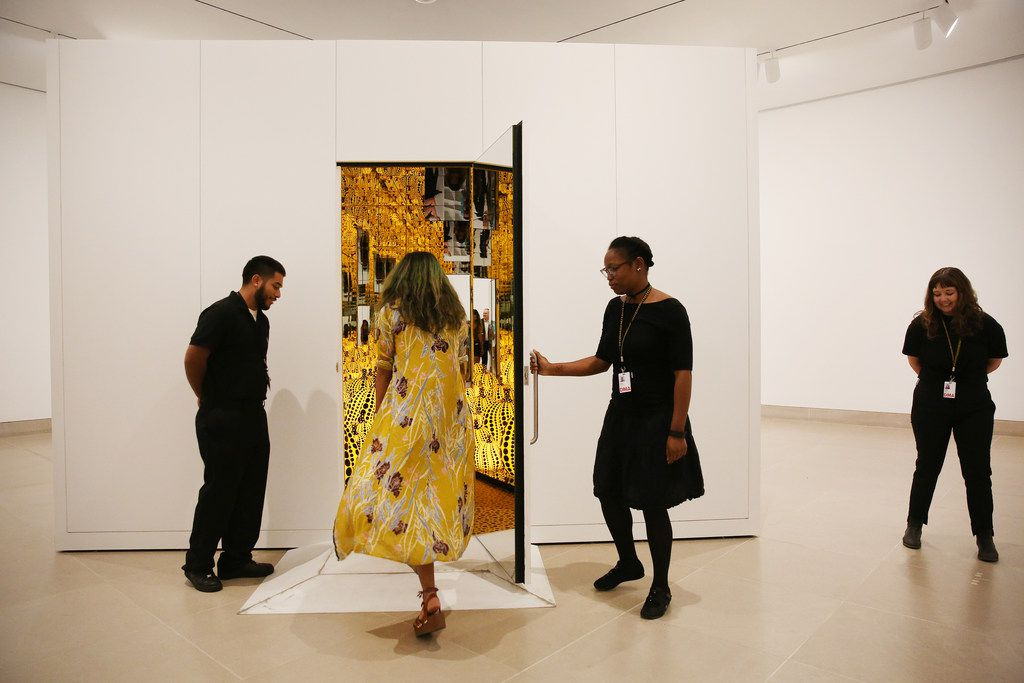 Guests enter during a preview of the exhibition 'Yayoi Kusama: All the Eternal Love I Have for the Pumpkins' at the Dallas Museum of Art on September 18, 2017.