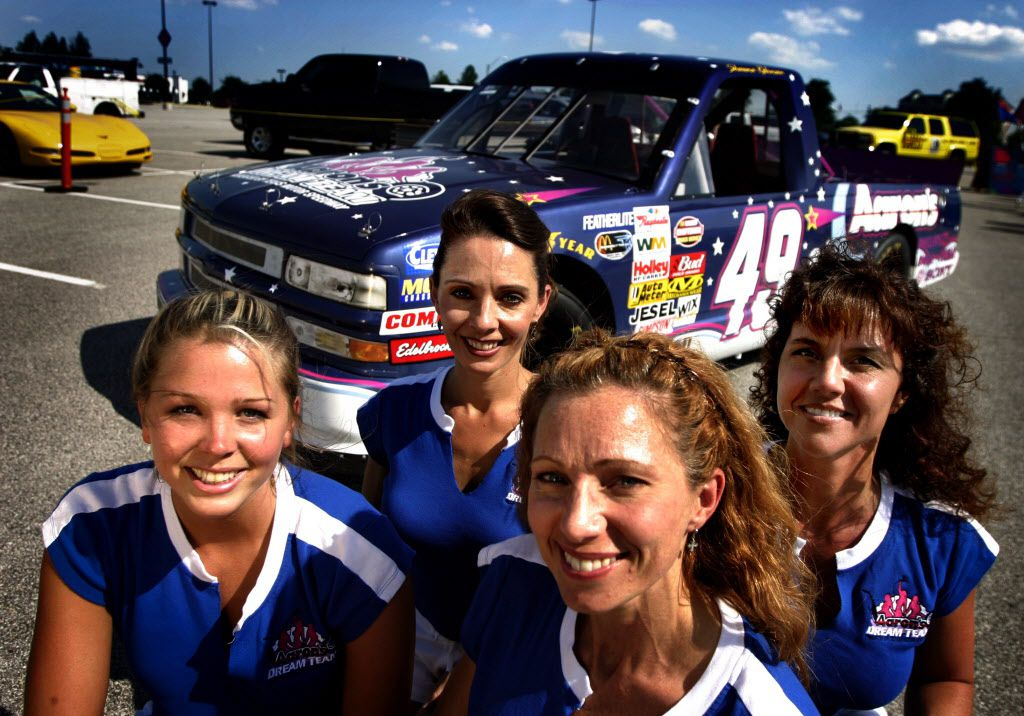 (From left) Geri Parris of Plano; Tracy Romagnoli of Prosper; Gina Tomaseski of Prosper; and Sandi Owens, 41, of Plano, make up part of Shawna Robinson's pit crew.  The crew is the first all-female crew to compete in the Nascar Touring Series competed in the O'Reilly 400K Nascar Craftsmen Truck Series at Texas Motor Speedway in 2003.