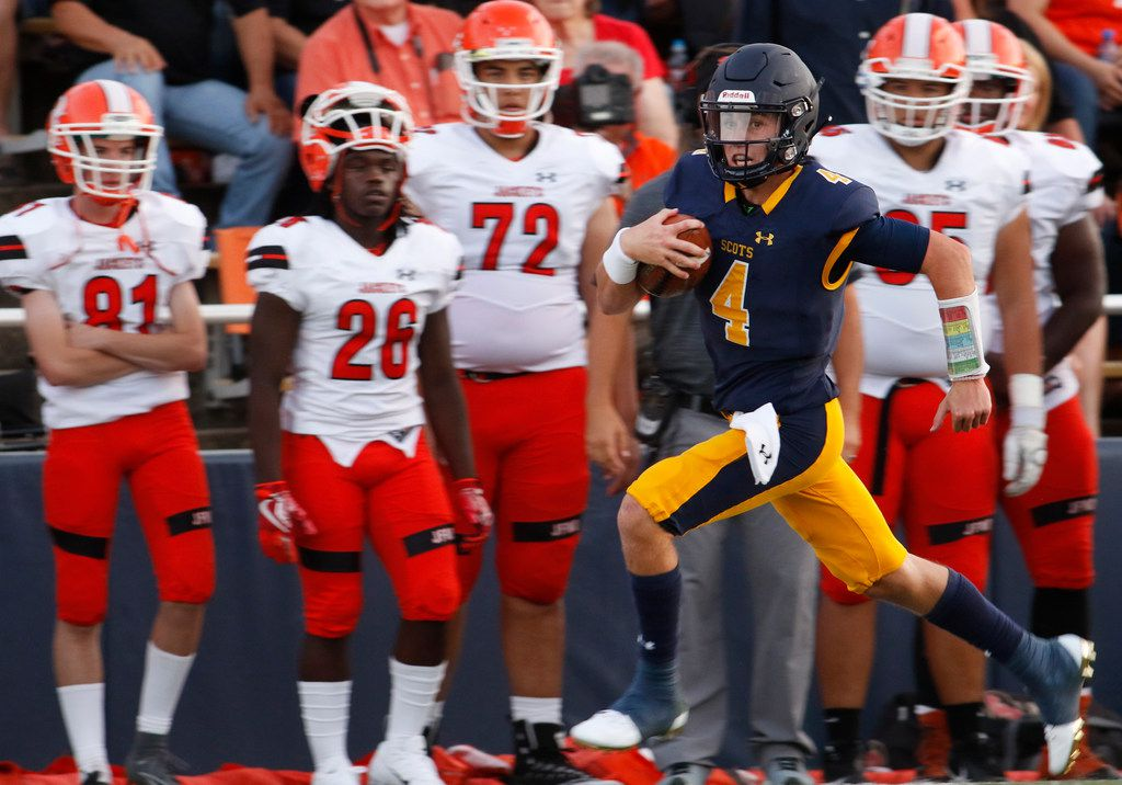 Highland Park quarterback Chandler Morris (4) races past the dismay of the Rockwall bench enroute to a 70-yard rushing touchdown to break a scoreless tie during the first quarter against Rockwall. The two teams played their non-district season opening football game at Highlander Stadium in Highland Park on August 31, 2018. (Steve Hamm/ Special Contributor)