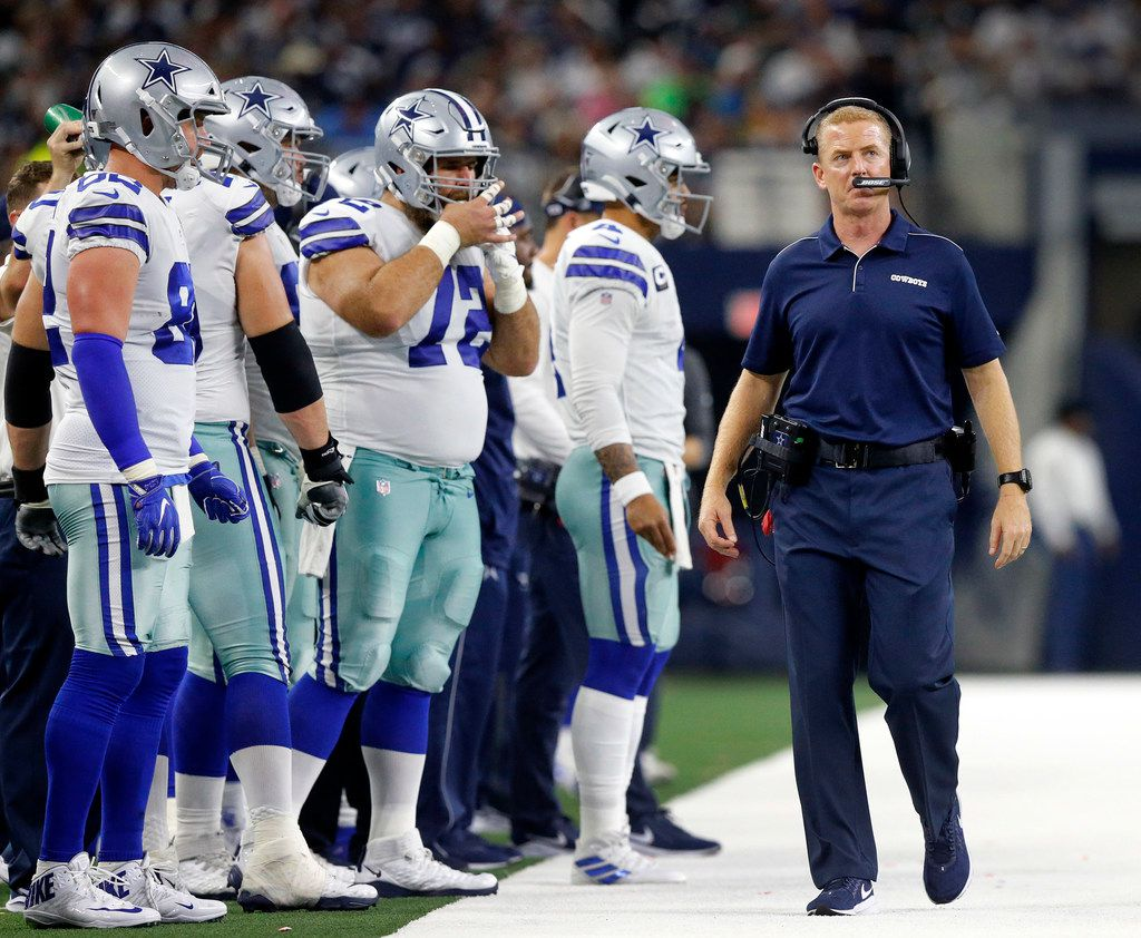 The Dallas Cowboys offense waits to get back on the field as head coach Jason Garrett paces the sideline against the Green Bay Packers in the third quarter at AT&T Stadium in Arlington, Texas, Sunday, October 6, 2019.