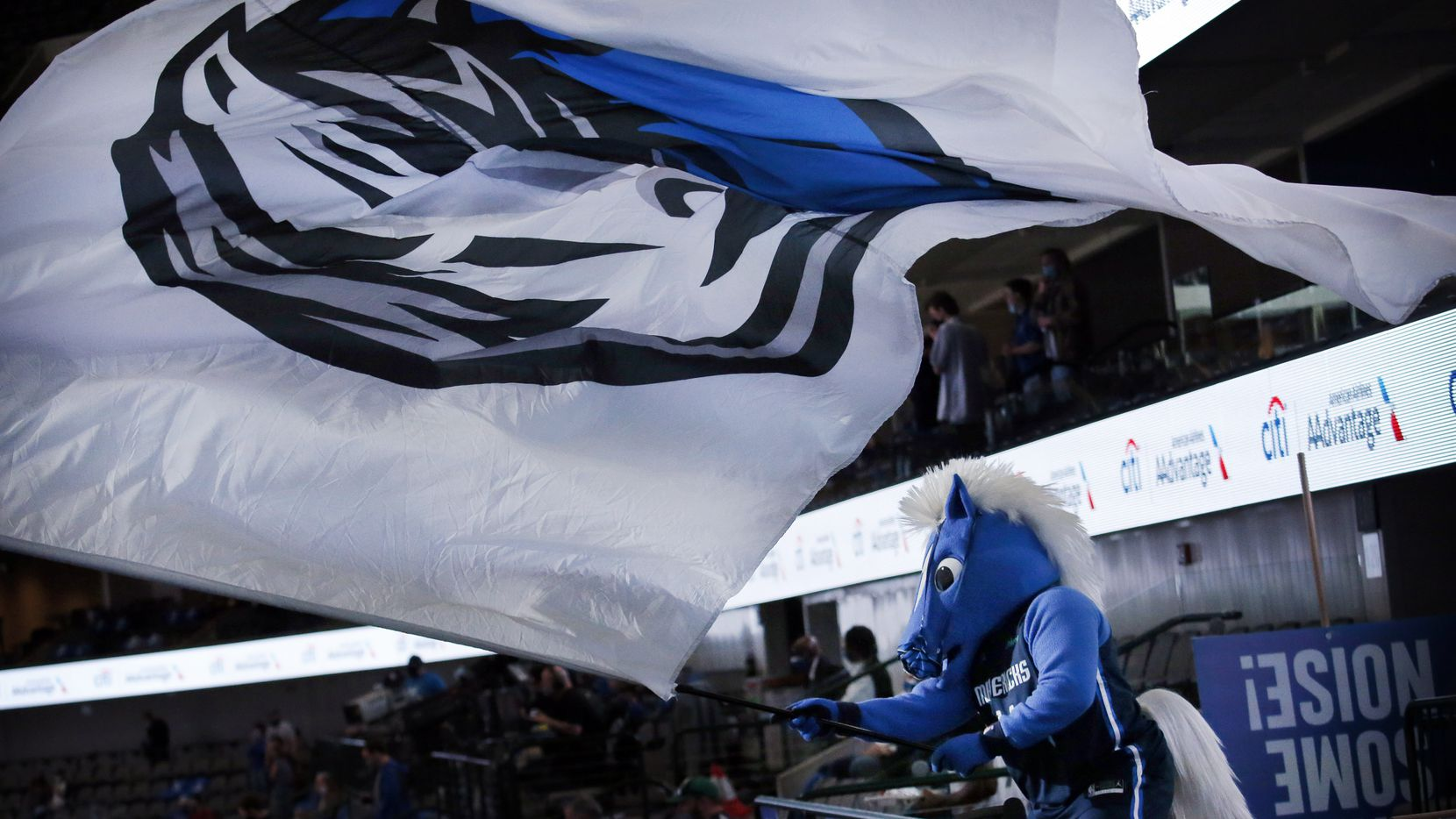 Dallas Mavericks mascot Champ waves the team flag from the main concourse as the players are introduced before the Boston Celtics game at the American Airlines Center in Dallas, Tuesday, February 23, 2021.